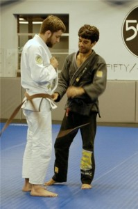 Felipe Costa giving Ryan Hall his black belt