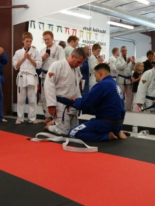 Brian Freeman getting his blue belt from Renzo Gracie